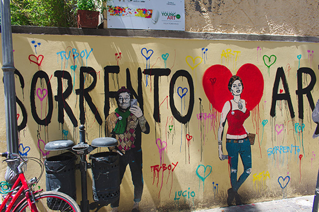 Street Art Sorrento, Bike in corner. Two young people - one male, one female. Lots of hearts